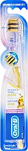 Fragrances, Perfumes, Cosmetics Toothbrush, gold - Oral-B UltrathinGum Care Gold Extra Soft